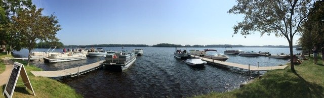 photo of lake docks and boats